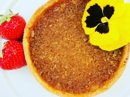 A sweet, tart made with sourdough crumbs and golden syrup