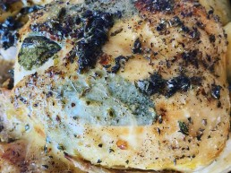 A whole roast chicken stuffed with sage and thyme