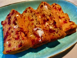 Colourful slices of a sweet potato bread with flecks of red and white from the beetroot and feta