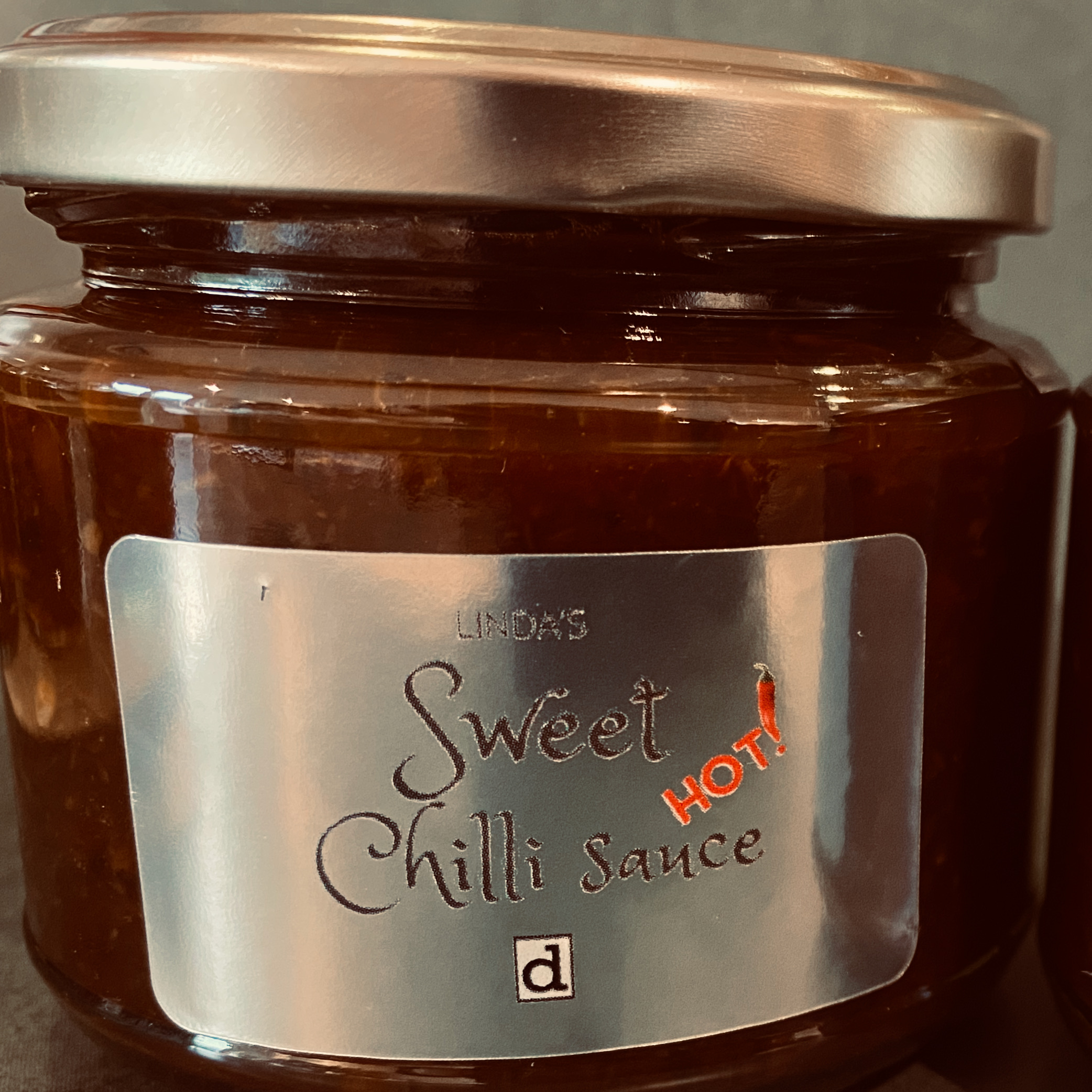 A jar of sweet chilli sauce with a shiny label
