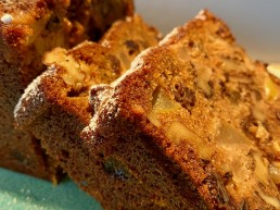 a slice of cake with pear rum and raisin